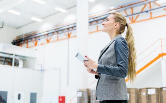Businesswoman standing at a modern warehouse